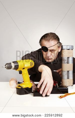 One-eyed Anarchist Manipulates Parts Of Tube Bomb