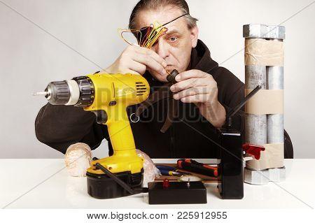 One-eyed Anarchist Making Classic Type Of Tube Bomb