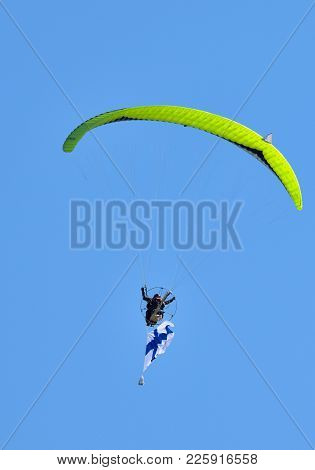 Helsinki, Finland - June 9: Unidentified Pilot Performing Aerobatics Stunts With A Paramotor And A F