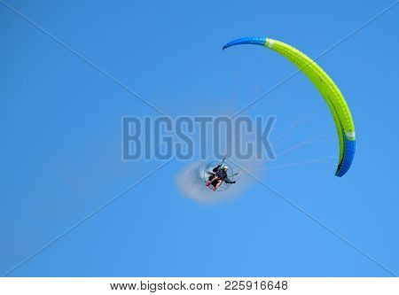 Helsinki, Finland - June 9: Unidentified Pilot Performing Aerobatics Stunts With A Paramotor In The