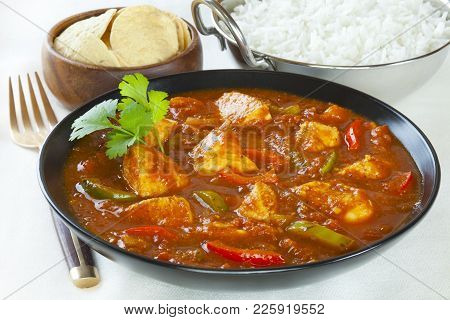 Chicken Jalfrezi With Rice And Poppadums. This Curry Was Invented By Indian Chefs In The Time Of The