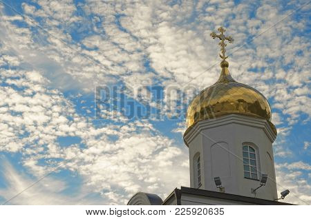 Gold Roof Of A Chirch With Cross In A Top Under Blue Cloudy Sky. Suitable For Any Purpose Use