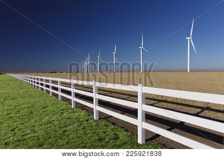 Wind Turbines Generating Power In Southern Idaho