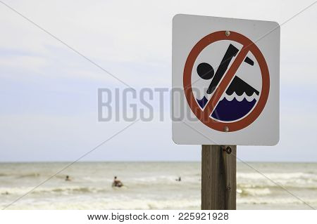 No Swimming Sign On A Gulf Of Mexico Beach In Galveston, Tx