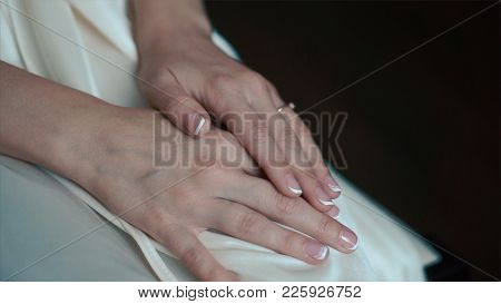 Bride's Hands With Ring. Wedding. Wedding Day. Hands Of The Bride Before Wedding. Wedding Accessorie