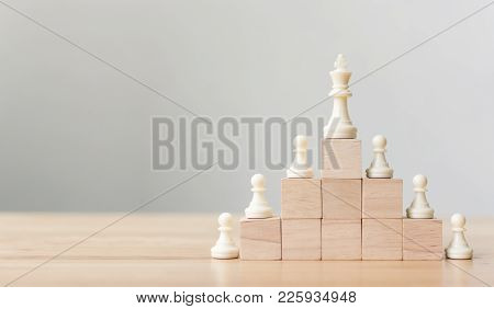 Business Leadership Concept With Chess On Top Wood Block Ladder Staircase. Team Leading Career For T