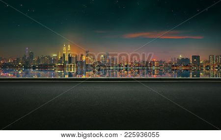 Panoramic view of asphalt road side with beautiful Kuala Lumpur city waterfront skyline. Night scene
