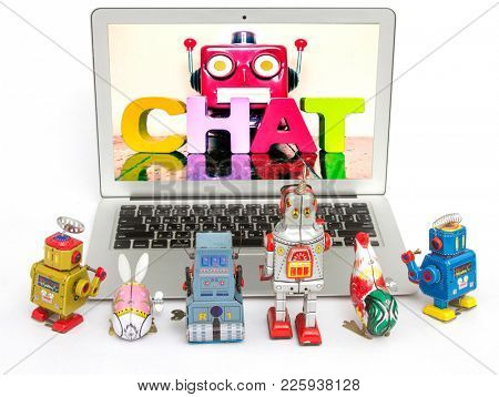 robot kids learn about  Chat Bots  on a laptop