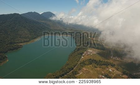 Aerial View Of Lake Tamblingan, A Caldera Lake At Bali. Beautiful Lake With Turquoise Water In The M