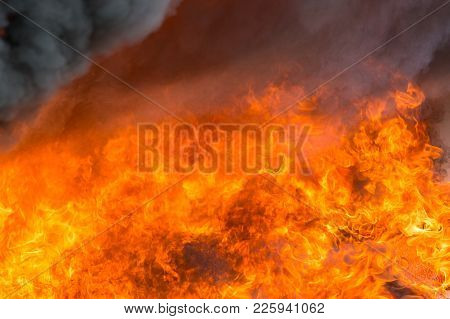 Fire And Smoke From Furniture Burning In Conflagration For Texture And Background