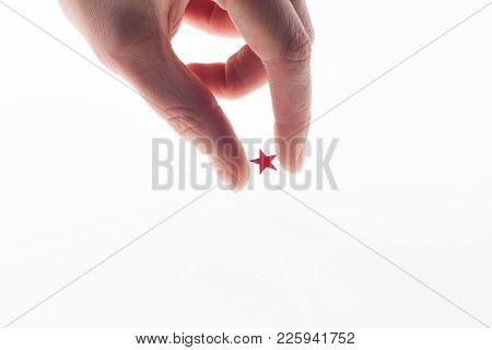 Small Red Star In Hand . Fingers Hold Star . All In Your Hands And Stars Or Reach For The Star Conce