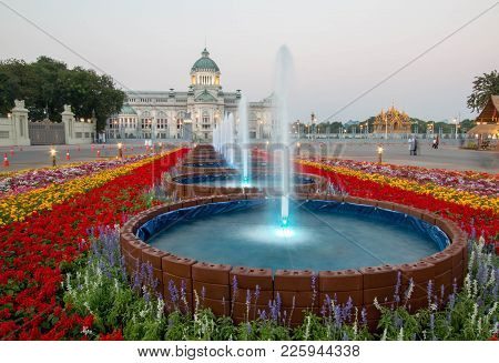 Bangkok, Thailand - February 6, 2018 : Fountain And Colorful Flowers With Ananta Samakhom Throne Hal