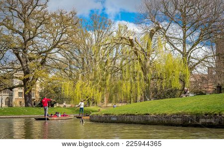 Cambridge, United Kingdom - 17 April, 2016  People Enjoying Punting On River Cam On A Bright Sunny D