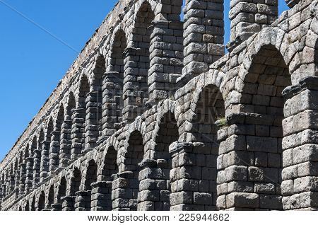Views Of The Aqueduct Of Segovia, Spain. It Is A Roman Aqueduct And The Date Of Construction Cannot