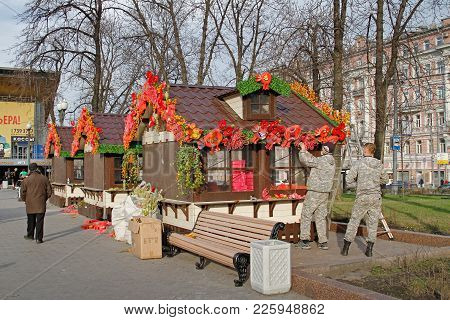 Moscow, Russia - April 18, 2016: Workers Decorate Trading Houses On Pushkin Square For  The Festival