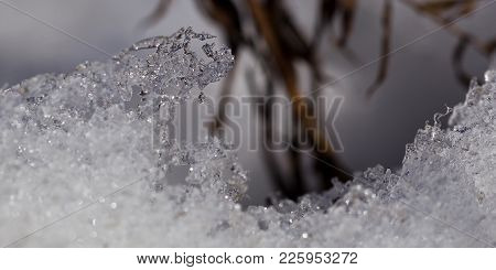 Art Photo Of Frozen Water, Crystals Of Snow And Ice Close-up On A Natural Blurred Background