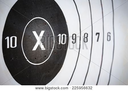 shooting paper target hit on x and 10 score for accuracy and business concept with copy space poster