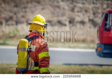 Fireman Walk To Fire Truck With Copy Space