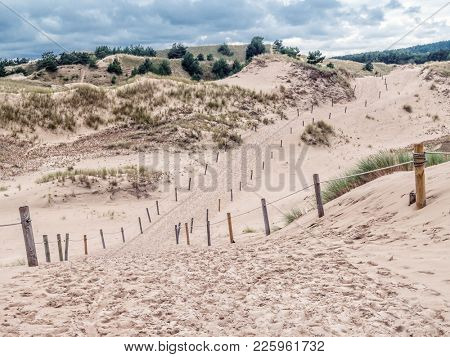 Sandy trail withing the moving dune Wydma Czolpinska in the the Slowinski National Park, Poland