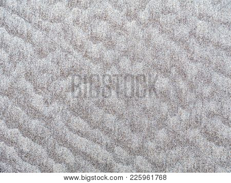 Background of beach sand ripples