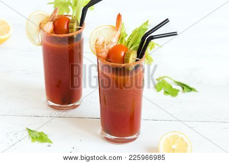 Bloody Mary Cocktail In Glasses With Garnishes. Tomato Bloody Mary Spicy Drink On White Background W