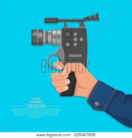 The Hand Of The Man Holds The Video Camera.design Elements. A Vector Illustration In Flat Style.