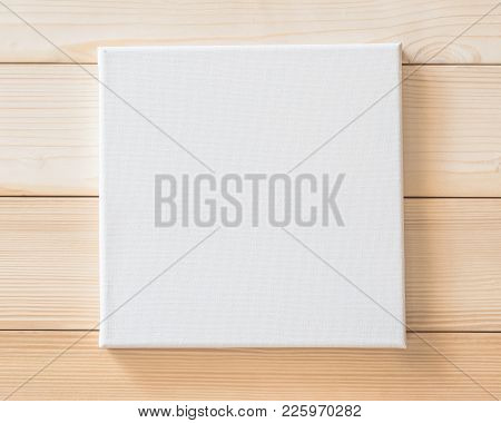 White Blank Canvas Mockup Square Size On Wood Wall For Arts Painting And Photo Hanging Interior Deco
