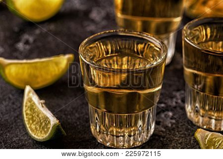 Tequila In Shot Glasses With Lime And Salt, Selective Focus.