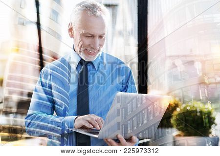 Productive Work. Experienced Smart Mature Businessman Feeling Happy While Having A Productive Workin