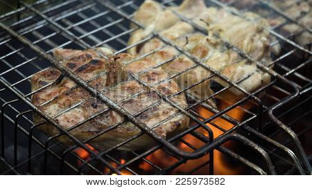 Barbecue With Delicious Grilled Meat On The Grill.barbecue Meat Is Fried Grill Grate.grilled Meats O