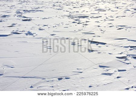 Winter Frozen River Ice-covered Surface White Background. Frosty Landscape Of Winter Nature, Ice On