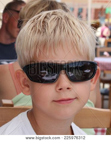 Nine-year-old Boy With Blond Hair In Sunglasses