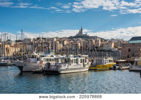 Marseille, France - December 4, 2016: View Of The Old Vieux Port And Basilica Notre Dame De La Garde