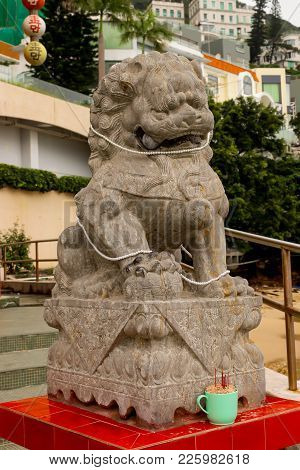 Close Up Single Stone Lion Statue In Repulse Bay Temple, Hong Kong