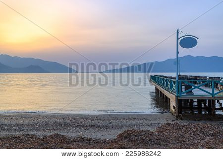 Pier With Seats During Sunset In Marmaris, Turkey