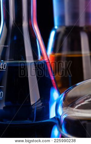 The Chemistry Lab Background. Various Glass Chemistry Lab Equipment On Black
