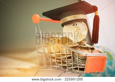 International Graduation Cap On Bitcoin Cryptocurrency On Coins Shopping Cart. Concept Of Blockchain