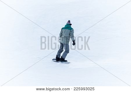 Rear View Of Sportsman With Snowboard
