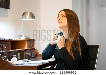 A Woman Reads Negative News In A Letter At Home At A Writing Desk. The News Of Getting Out Of Work.