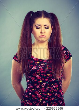 Young Teenage Woman Being Offended By Something, Feeling Unhappy And Sad. Adolescence Problems Conce