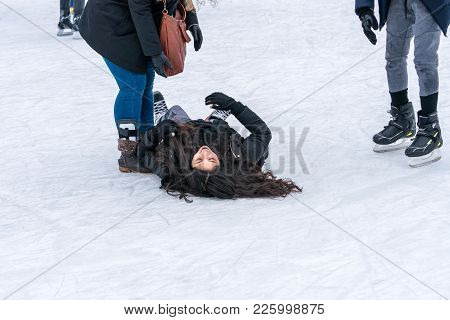 Stockholm, Sweden - February 3, 2018: Side View Of A Woman Lying On Her Back On The Ice When Skating