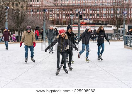 Stockholm, Sweden - February 3, 2018: Front View Of Several Young And Old People Skating At A Public