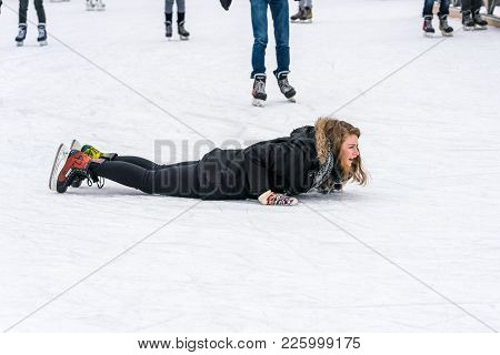 Stockholm, Sweden - February 3, 2018: Side View Of A Woman Lying On Her Stomach On The Ice When Skat