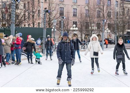 Stockholm, Sweden - February 3, 2018: Front View Of A Young Man Skating At A Public Ice Skating Rink