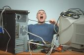 Overloaded computer repairman tired from his work and and strangles himself with a cord from the computer. Computer technician. PC repair service center. poster