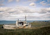 Old abandon wooden fishing boat on the Magdalen Islands poster