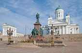 Helsinki. Finland. Senate Square. Helsinki Cathedral also known as a St Nicholas Church and Alexander II Sculpture in the foreground poster