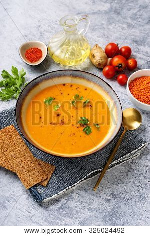Winter Spicy Lentil Cream Soup On Light Blue Background