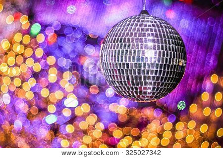 Disco Ball With With Bokeh Defocused Lights. Night Party Background Photo. Disco Party. Blurred, Abs