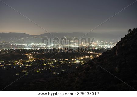 Night view towards Woodland Hills and Warner Center in the San Fernando Valley area of Los Angeles, California.